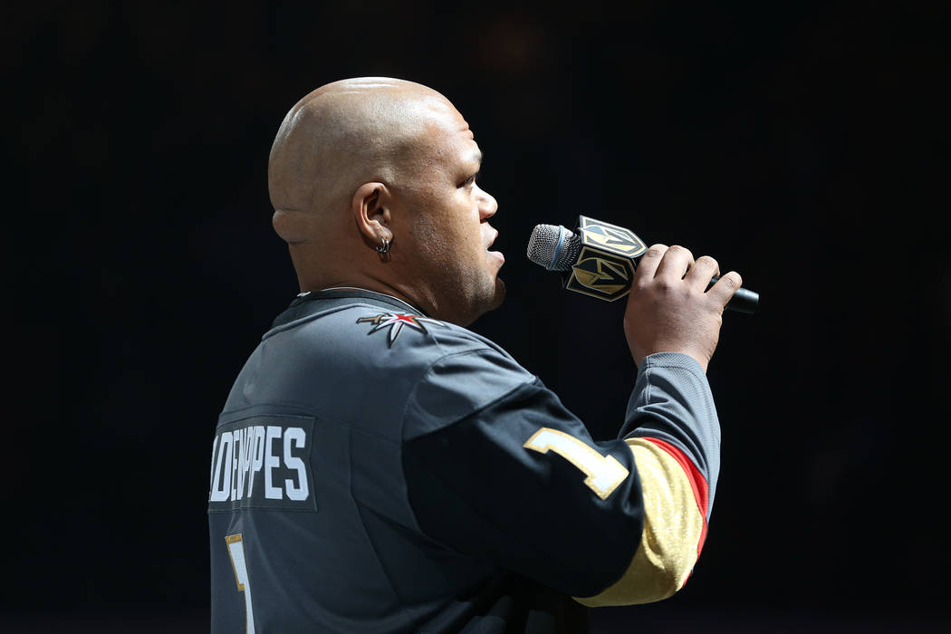 Carnell Johnson, also known as Golden Pipes, sings the national anthem during the Vegas Golden Knights season opener against the Philadelphia Flyers at T-Mobile Arena in Las Vegas, Thursday, Oct. ...
