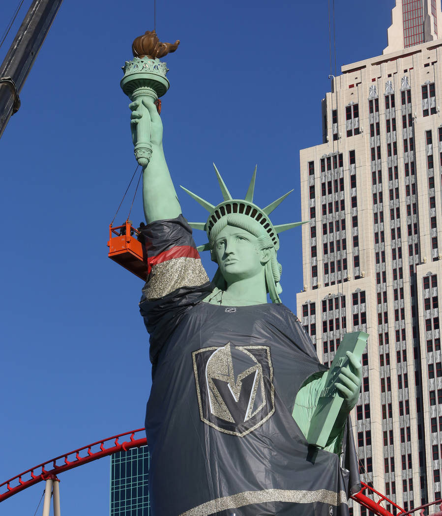 Workers install a Vegas Golden Knights jersey on the Statue of Liberty at New York New York on Friday, April 13, 2018, in Las Vegas. Bizuayehu Tesfaye/Las Vegas Review-Journal @bizutesfaye