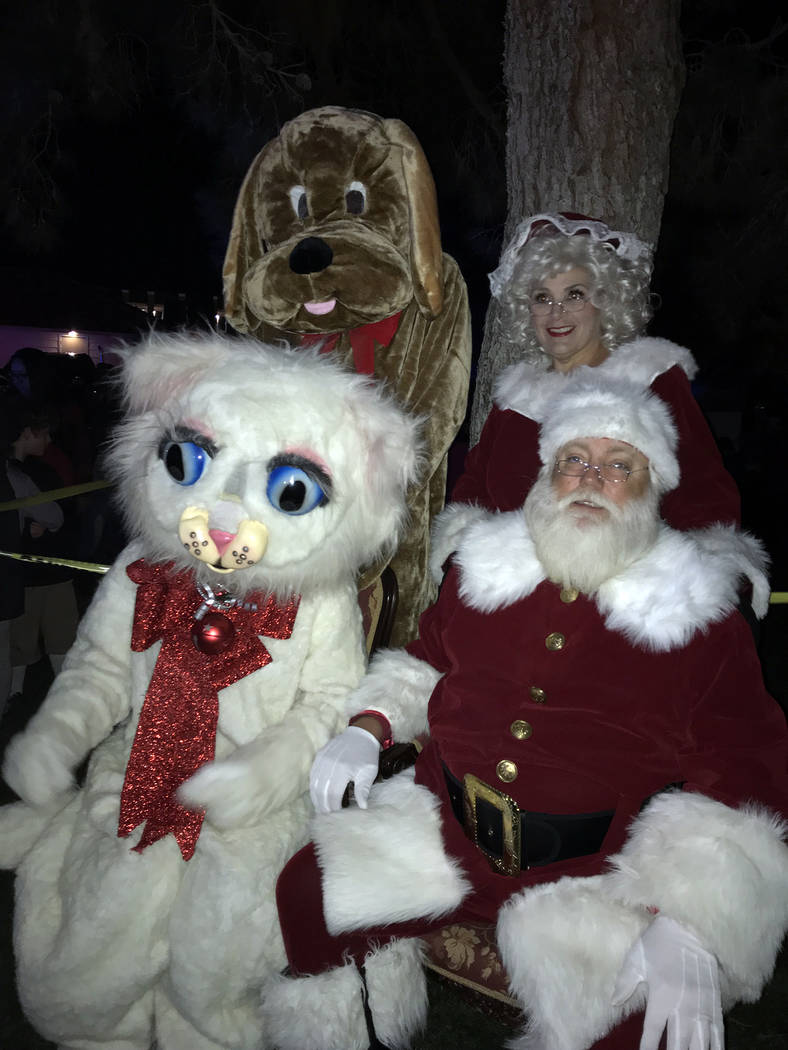 (Hali Bernstein Saylor/Boulder City Review) Santa and Mrs. Claus were joined by Jingle Cat and her new friend, Hoover the Dam Dog, who was rescued from the Boulder City Animal Shelter, for the cit ...