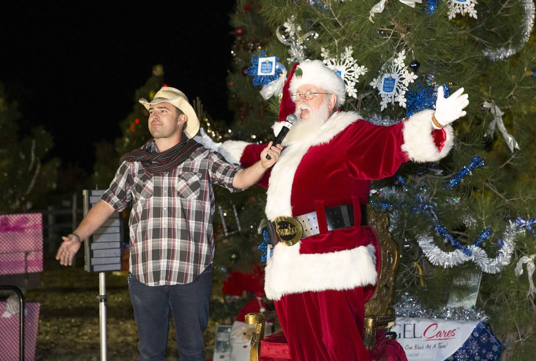 Emcee Walt Turner and Santa Claus prepare to light the Christmas tree during Cowboy Christmas at Floyd Lamb Park at Tule Springs in Las Vegas on Saturday, Dec. 1, 2018. Richard Brian Las Vegas Rev ...