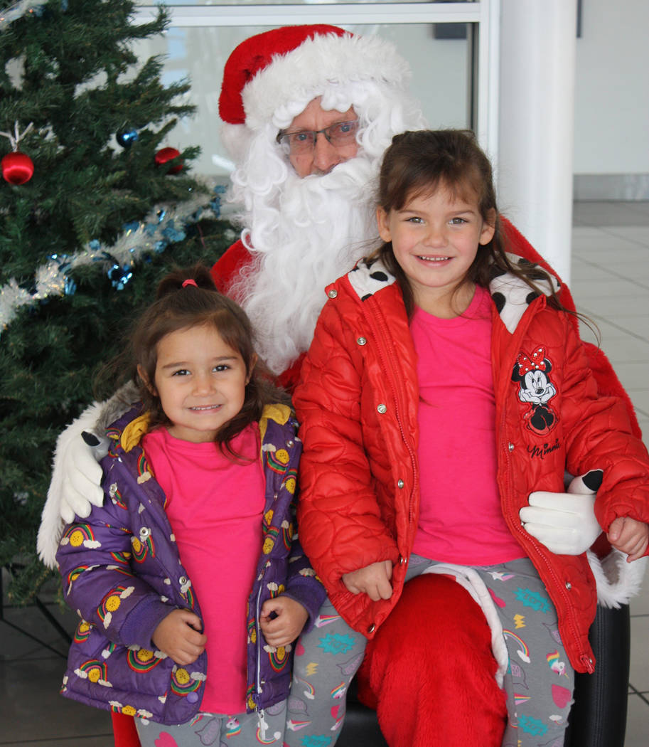 Robin Hebrock/Pahrump Valley Times Santa Claus poses with valley youngsters Maddie and Quinn Ramos during the Pahrump Valley Lions Club's annual Breakfast with Santa, which took place Dec. 1 at th ...