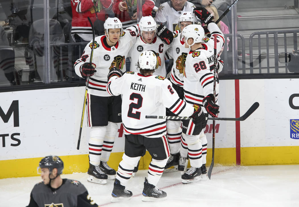 The Chicago Blackhawks celebrate a second period goal by Chicago Blackhawks center Jonathan Toews (19), top center, during an NHL hockey game against the Vegas Golden Knights at T-Mobile Arena in ...