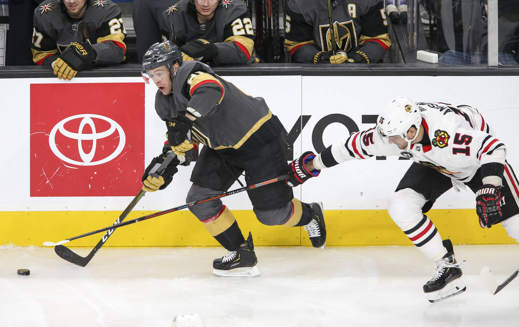 Vegas Golden Knights center Jonathan Marchessault (81) carries the puck as Chicago Blackhawks center Artem Anisimov (15) defends during the third period of an NHL hockey game at T-Mobile Arena in ...