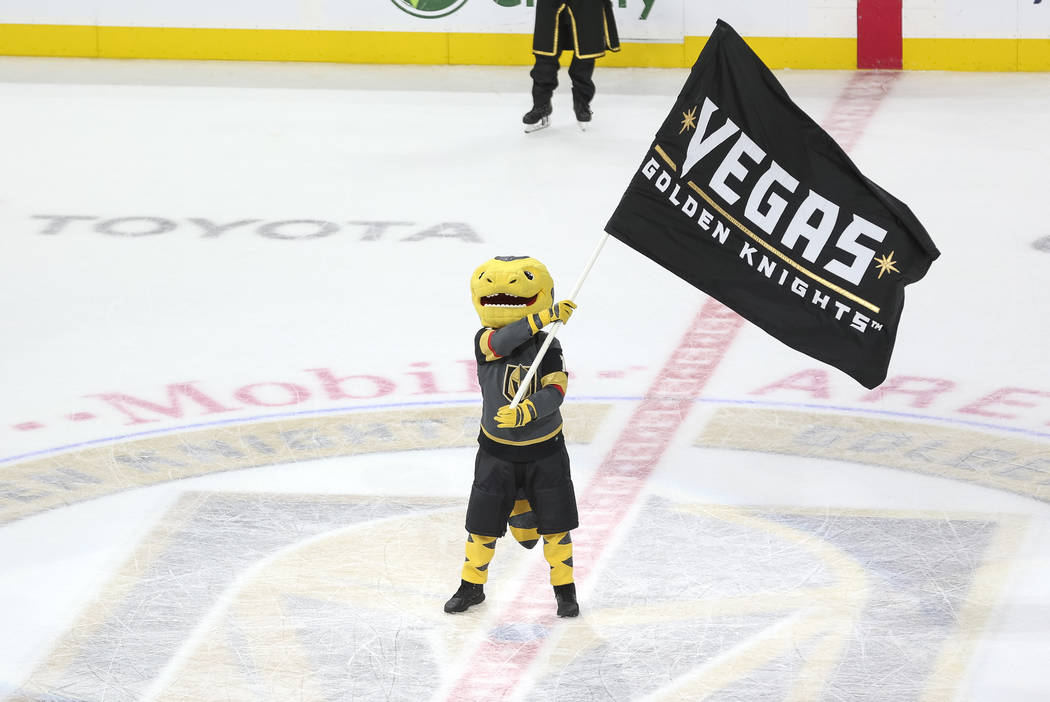 Chance the Gila Monster celebrates the Vegas Golden Knights 4-3 victory over the Chicago Blackhawks following an NHL hockey game at T-Mobile Arena in Las Vegas, Thursday, Dec. 6, 2018. Richard Bri ...