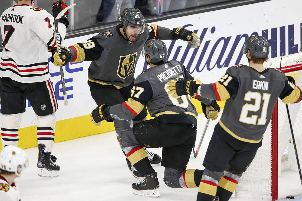 Vegas Golden Knights right wing Alex Tuch (89) celebrates his third period goal with left wing Max Pacioretty (67) during an NHL hockey game against the Chicago Blackhawks at T-Mobile Arena in Las ...