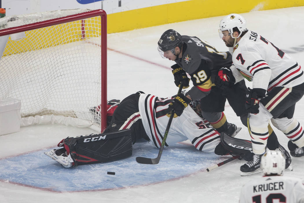 Vegas Golden Knights right wing Reilly Smith (19) lines up the puck for a goal past Chicago Blackhawks goaltender Corey Crawford (50) and Blackhawks defenseman Brent Seabrook (7) during the first ...