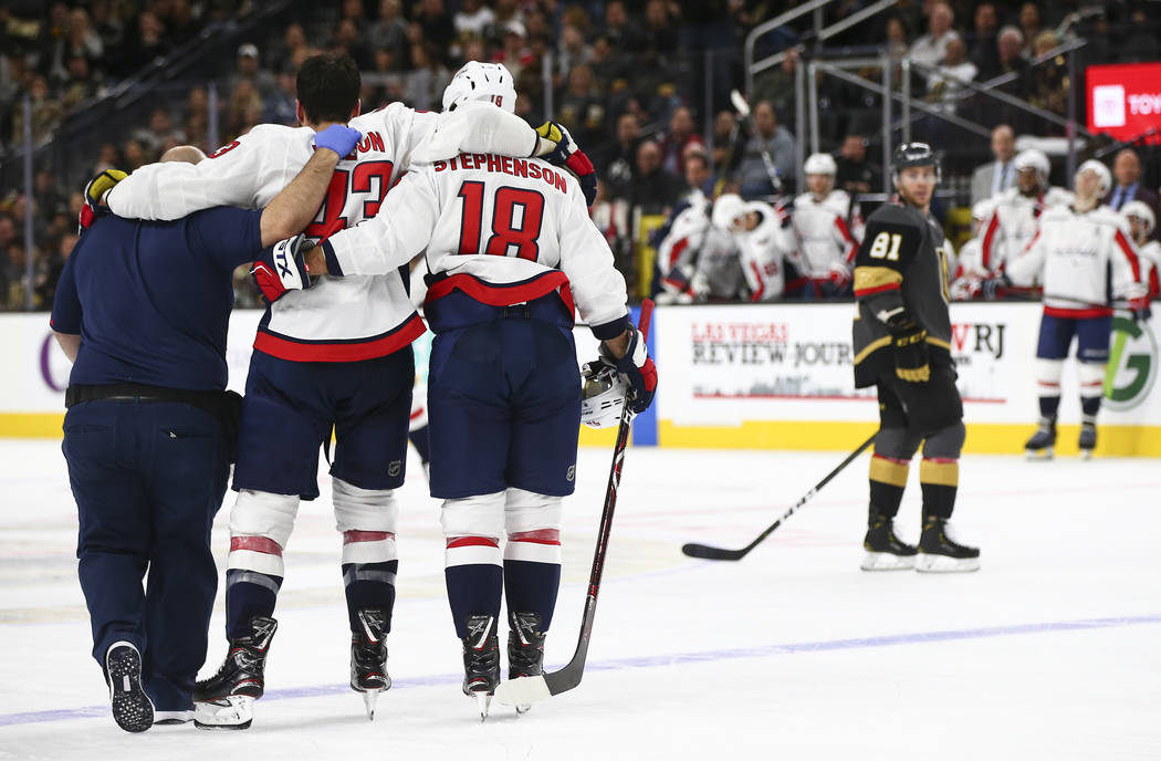 Washington Capitals right wing Tom Wilson (43) is helped off the ice after taking a hit from Golden Knights right wing Ryan Reaves, not pictured, during the second period of an NHL hockey game at ...