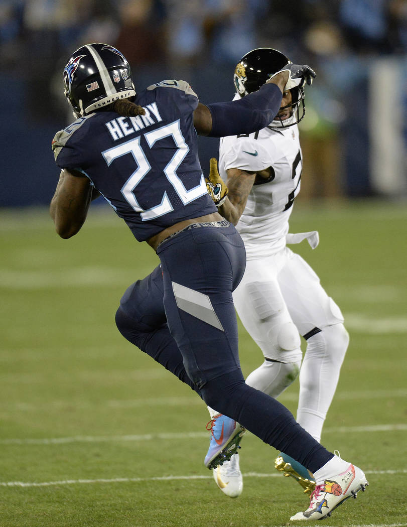Tennessee Titans running back Derrick Henry (22) runs against Jacksonville Jaguars cornerback A.J. Bouye (21) during the first half of an NFL football game, Thursday, Dec. 6, 2018, in Nashville, T ...