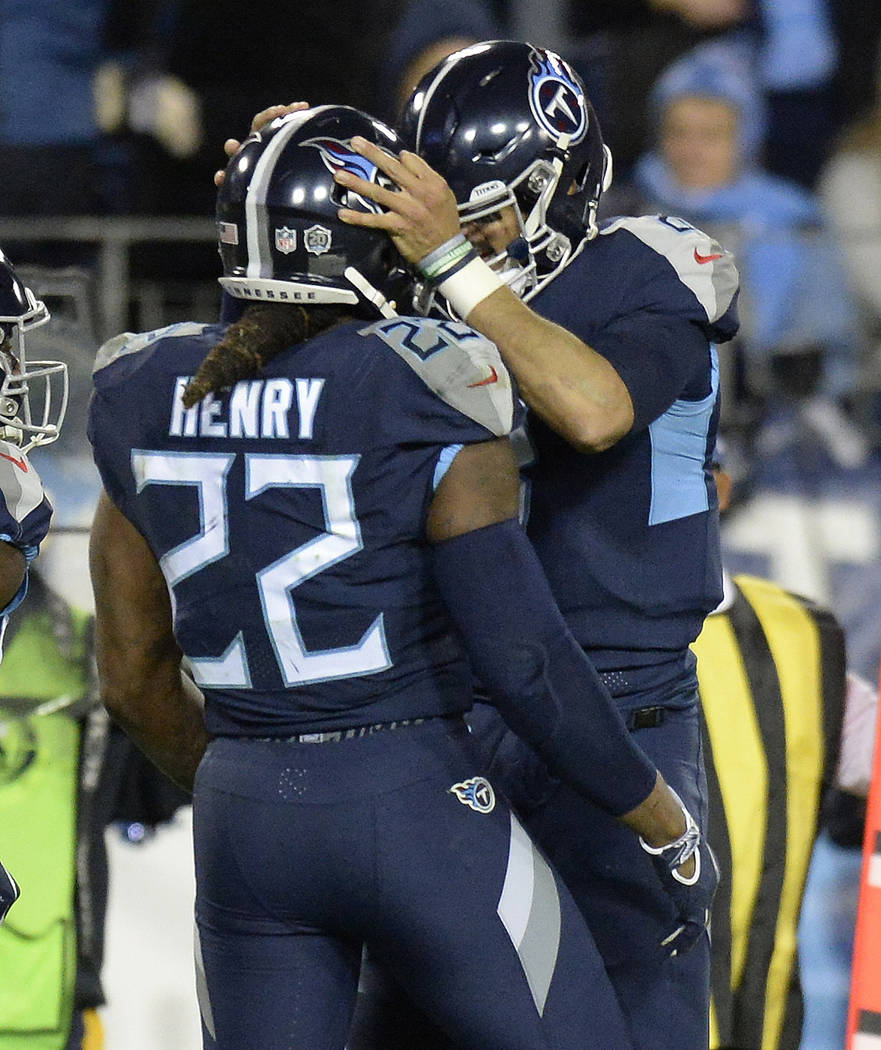 Tennessee Titans running back Derrick Henry (22) celebrates his touchdown with Tennessee Titans quarterback Marcus Mariota (8) during the second half of an NFL football game against the Jacksonvil ...
