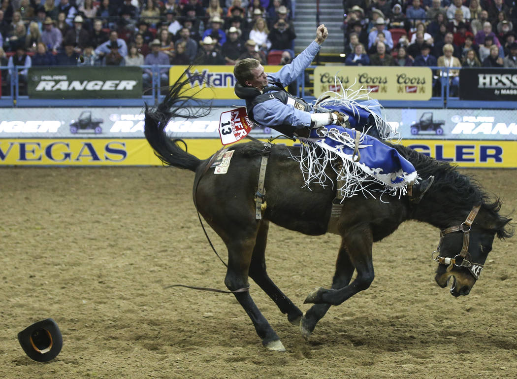 "Orin Larsen of Manitoba, Canada rides ""Imperial Beach"" while competing in bareback riding during the opening night of the National Finals Rodeo at the Thomas & Mack Center in Las Veg ..."