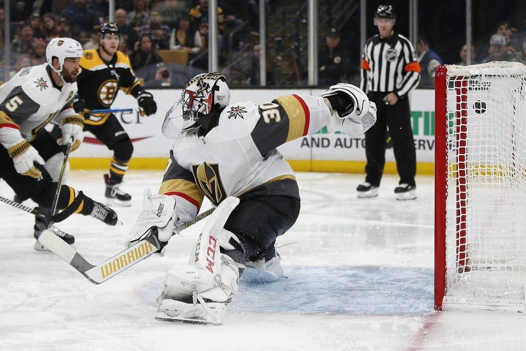 The goal by Boston Bruins' Brad Marchand enter the net behind Vegas Golden Knights' Malcolm Subban (30) during the second period of an NHL hockey game in Boston, Sunday, Nov. 11, 2018. (AP Photo/M ...