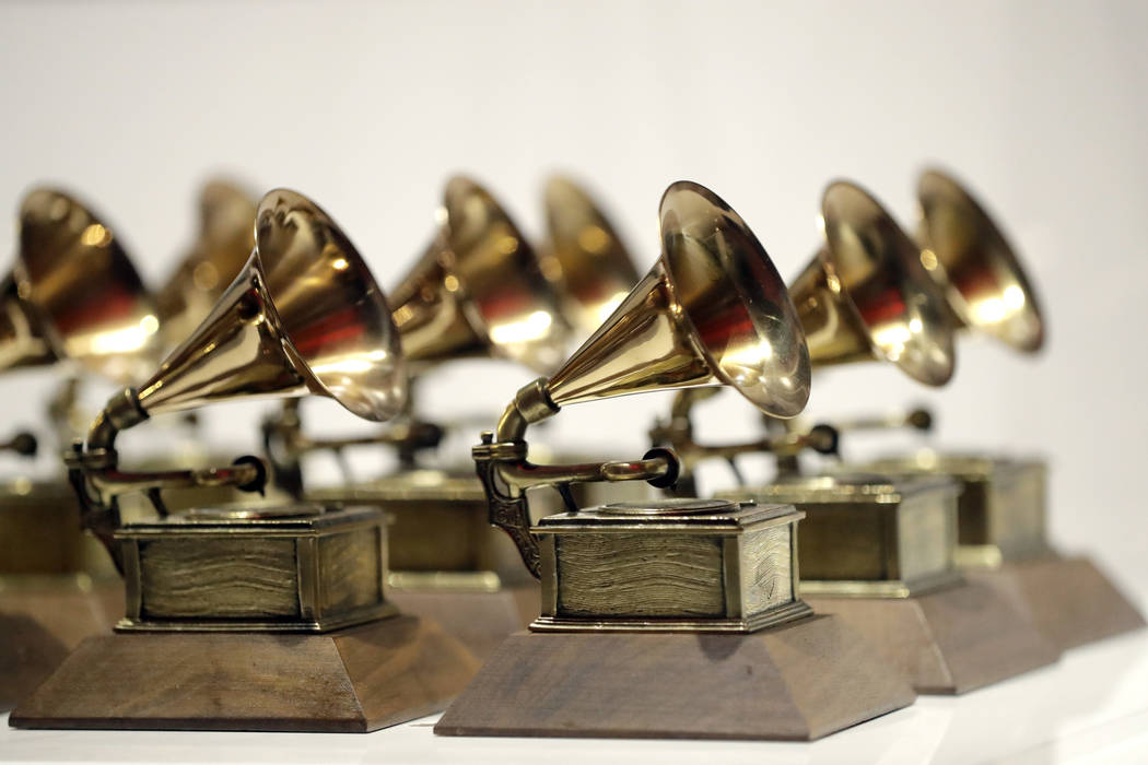 FILE - In this Oct. 10, 2017, file photo, various Grammy Awards are displayed at the Grammy Museum Experience at Prudential Center in Newark, N.J. Nominations for the 61st annual Grammy Awards wil ...