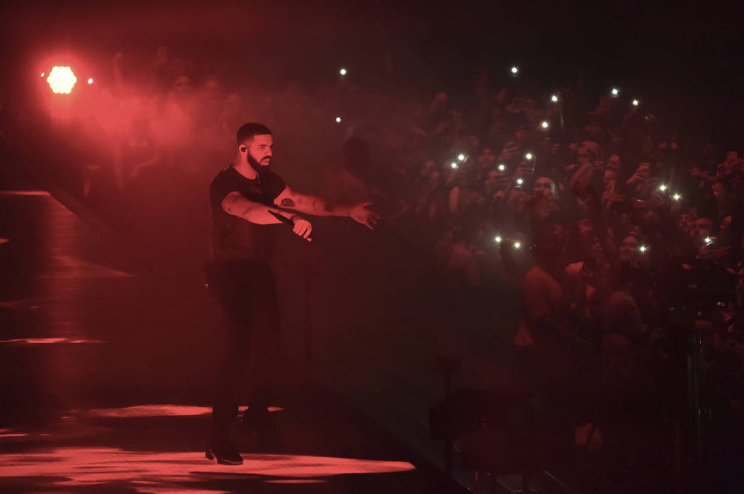 FILE- In this Oct. 12, 2018, file photo Drake performs at the Staples Center in Los Angeles. A list of nominees in the top categories at the 2019 Grammys, including Kendrick Lamar, who is the lead ...