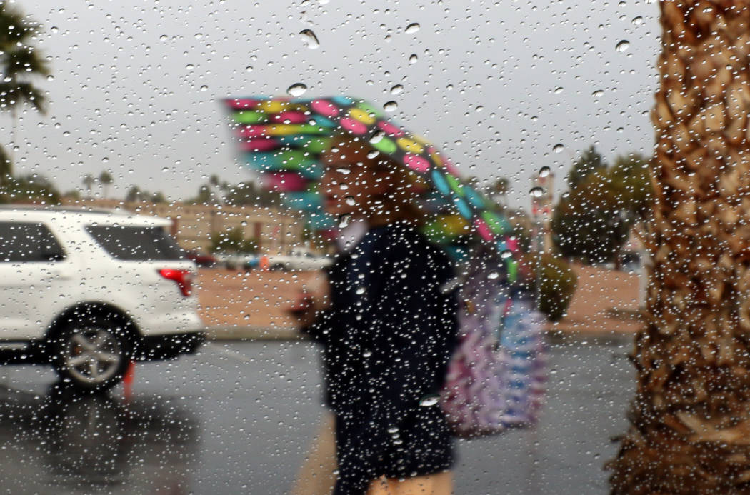 A student at St. Viator Elementary School walks to school during rainstorm on Friday, Dec. 7, 2018, in Las Vegas. Bizuayehu Tesfaye Las Vegas Review-Journal @bizutesfaye