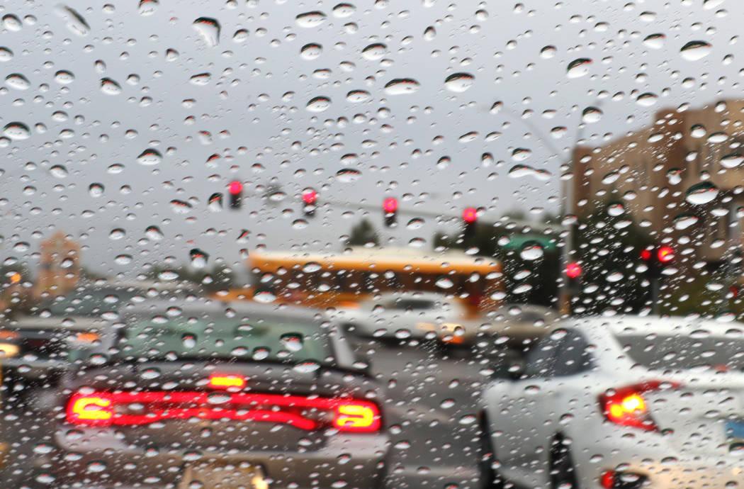 Rain drops on a car windshield are seen in traffic jam during rainstorm on Friday, Dec. 7, 2018, in Las Vegas. Bizuayehu Tesfaye Las Vegas Review-Journal @bizutesfaye
