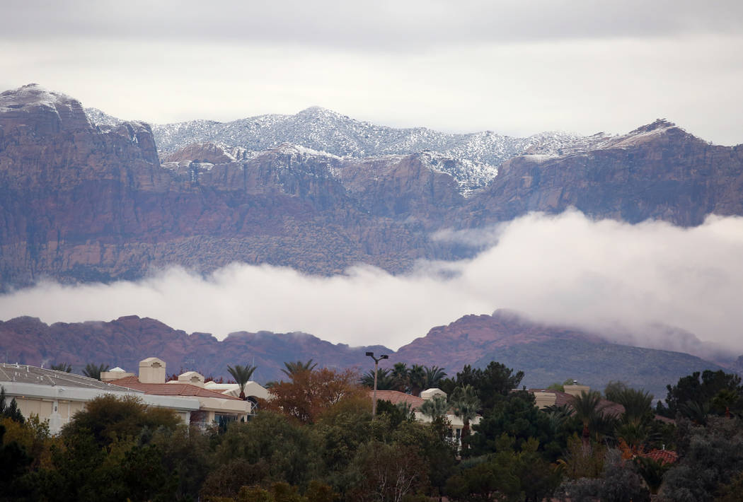 Clouds loom between mountains at Red Rock on Friday, Dec. 7, 2018, in Las Vegas. Bizuayehu Tesfaye Las Vegas Review-Journal @bizutesfaye