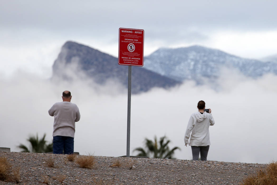Tom Romand and his daughter Gabriella take a picture as clouds loom over Red Rock Canyon on Friday, Dec. 7, 2018, in Las Vegas. Bizuayehu Tesfaye Las Vegas Review-Journal @bizutesfaye