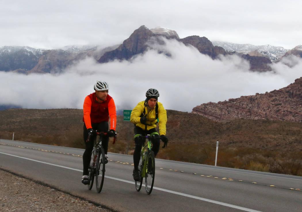 Bicyclists ride their bikes as clouds loom over Red Rock Canyon on Friday, Dec. 7, 2018, in Las Vegas. Bizuayehu Tesfaye Las Vegas Review-Journal @bizutesfaye