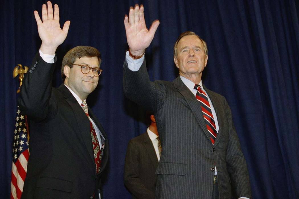 In this Nov. 26, 1991, file photo, President George H.W Bush, right, and William Barr wave after Barr was sworn in as the new Attorney General of the United States at a Justice Department ceremony ...