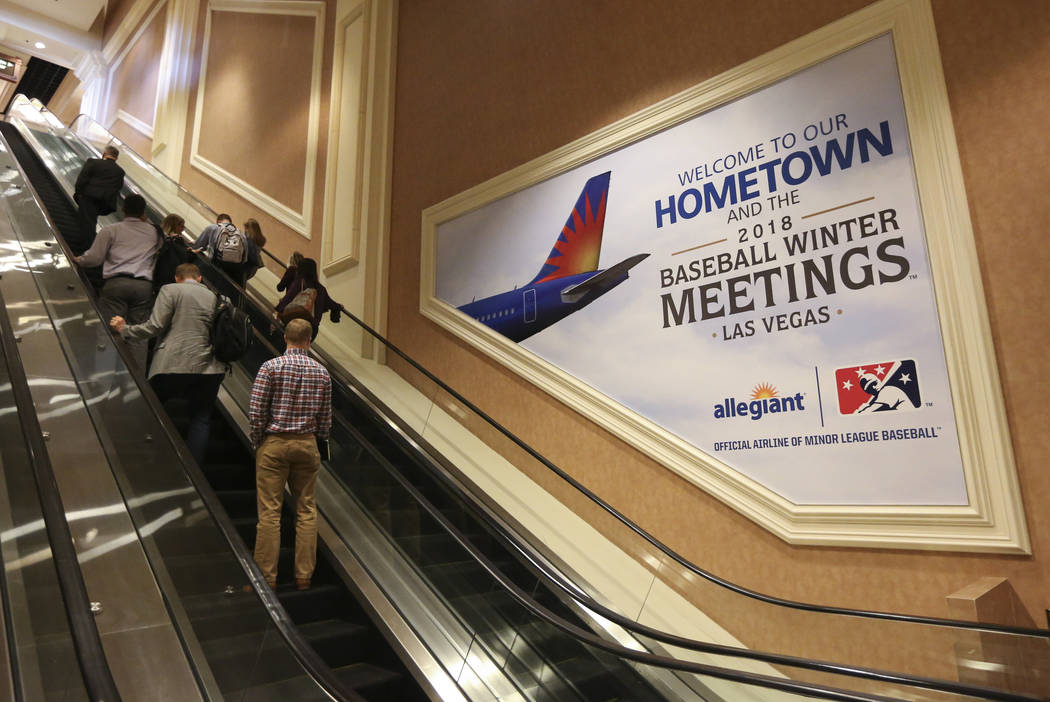 Attendees pass by signage for Allegiant Air and Major League Baseball's winter meetings at Mandalay Bay in Las Vegas on Sunday, Dec. 9, 2018. Chase Stevens Las Vegas Review-Journal @csstevensphoto