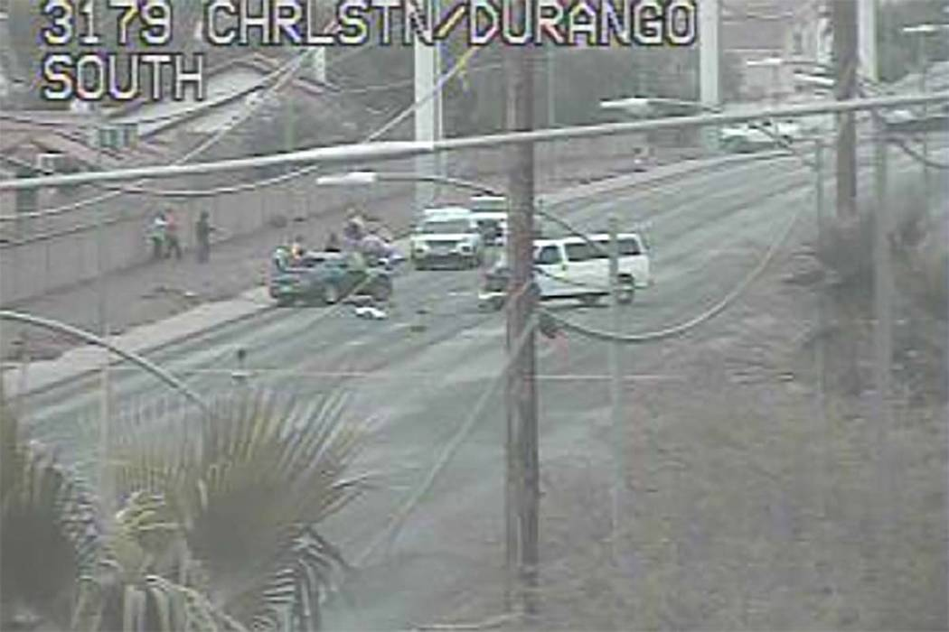 Las Vegas police investigate a crash on Durango Avenue near Oakley Boulevard, Friday, Dec. 7, 2018. (RTC Cameras)