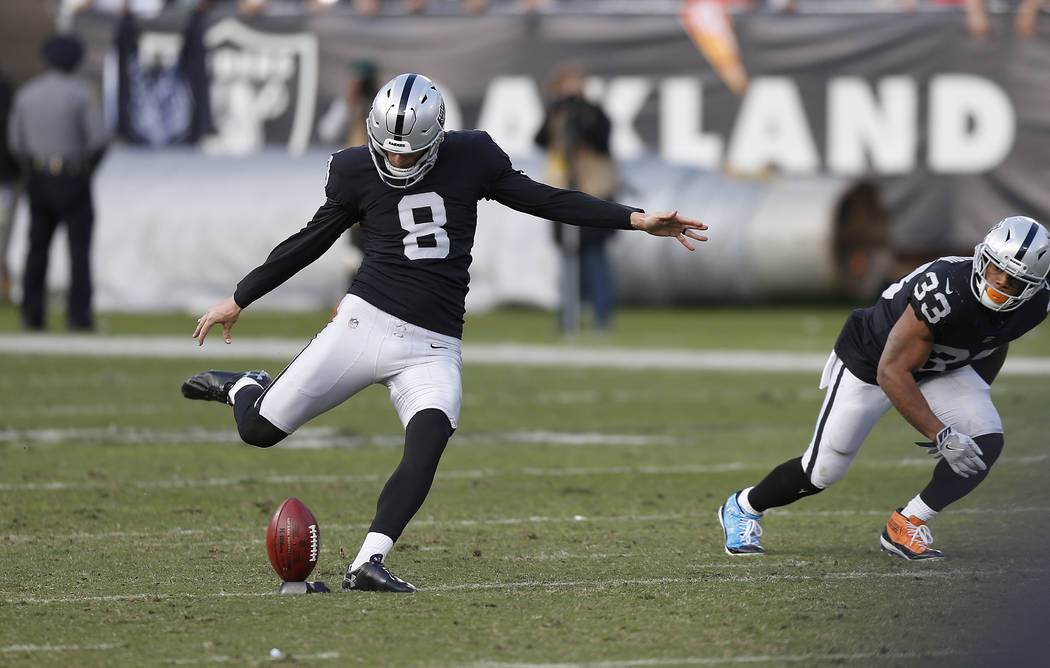 Oakland Raiders kicker Daniel Carlson (8) kicks off against the Kansas City Chiefs during an NFL football game in Oakland, Calif., Sunday, Dec. 2, 2018. (AP Photo/D. Ross Cameron)