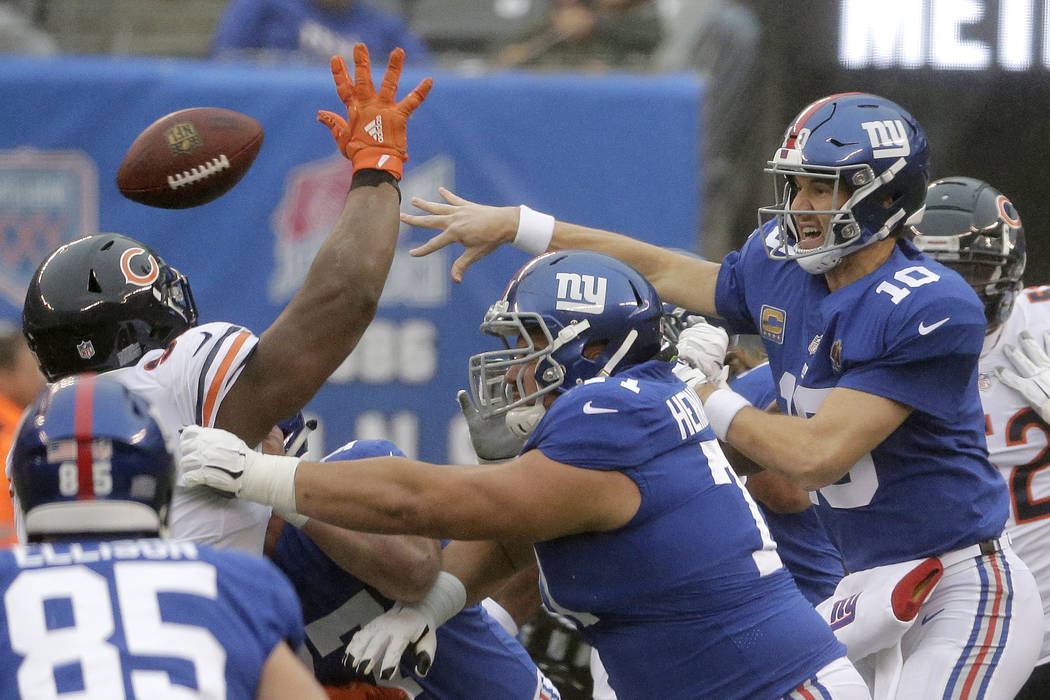 New York Giants quarterback Eli Manning (10) throws a pass against the Chicago Bears during the first half of an NFL football game, Sunday, Dec. 2, 2018, in East Rutherford, N.J. (AP Photo/Seth Wenig)