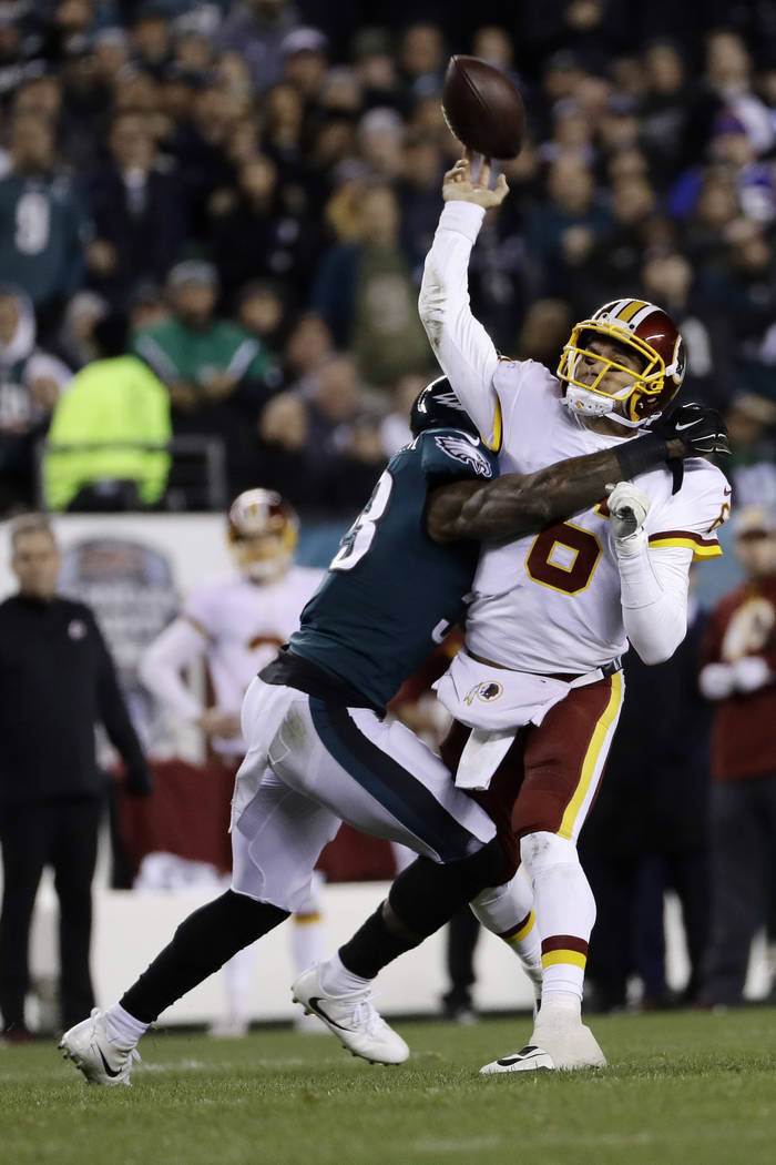 Washington Redskins' Mark Sanchez (6) is hit by Philadelphia Eagles' Nigel Bradham (53) during the first half of an NFL football game, Monday, Dec. 3, 2018, in Philadelphia. (AP Photo/Michael Perez)