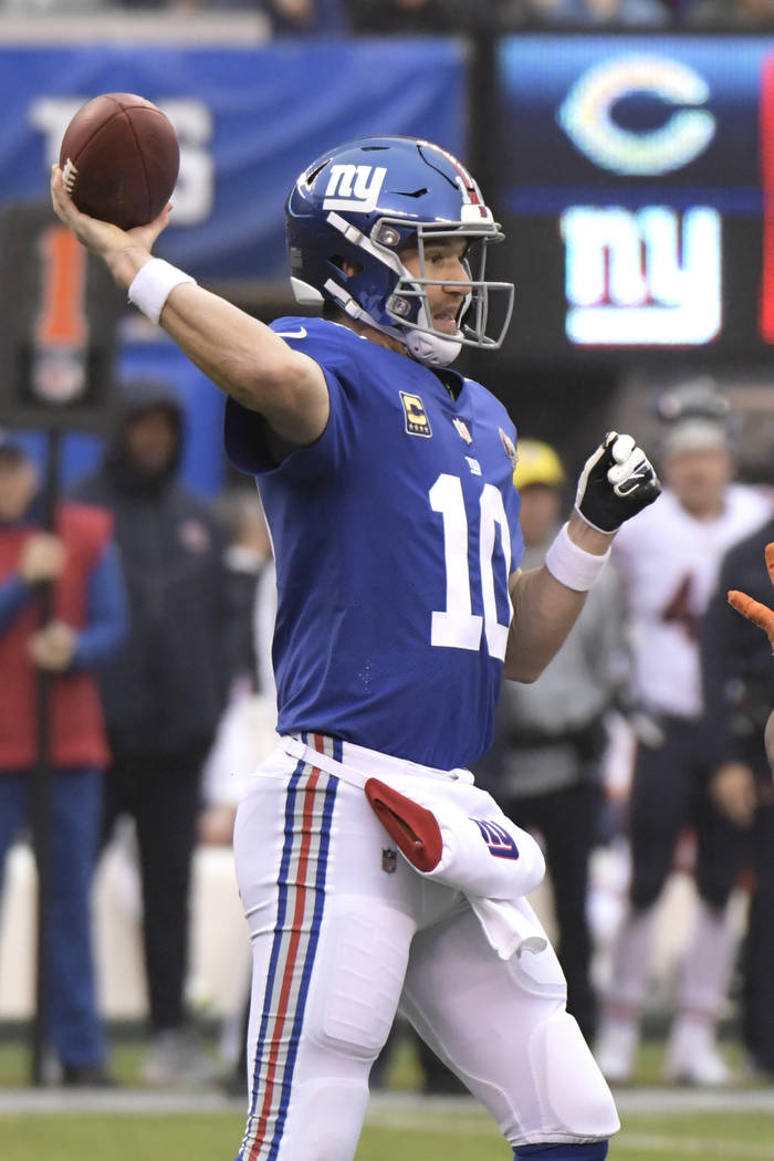 New York Giants quarterback Eli Manning (10) throws a pass during the first half of an NFL football game against the Chicago Bears, Sunday, Dec. 2, 2018, in East Rutherford, N.J. (AP Photo/Bill Ko ...