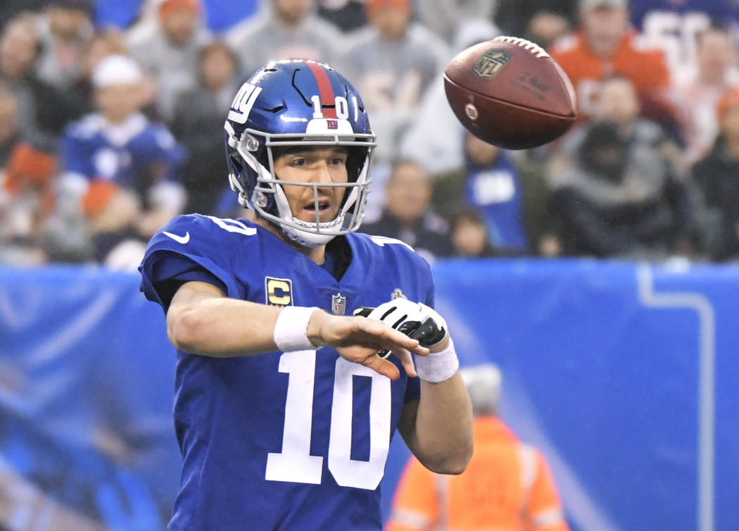 New York Giants quarterback Eli Manning (10) throws a pass during the second half of an NFL football game against the Chicago Bears, Sunday, Dec. 2, 2018, in East Rutherford, N.J. (AP Photo/Bill K ...