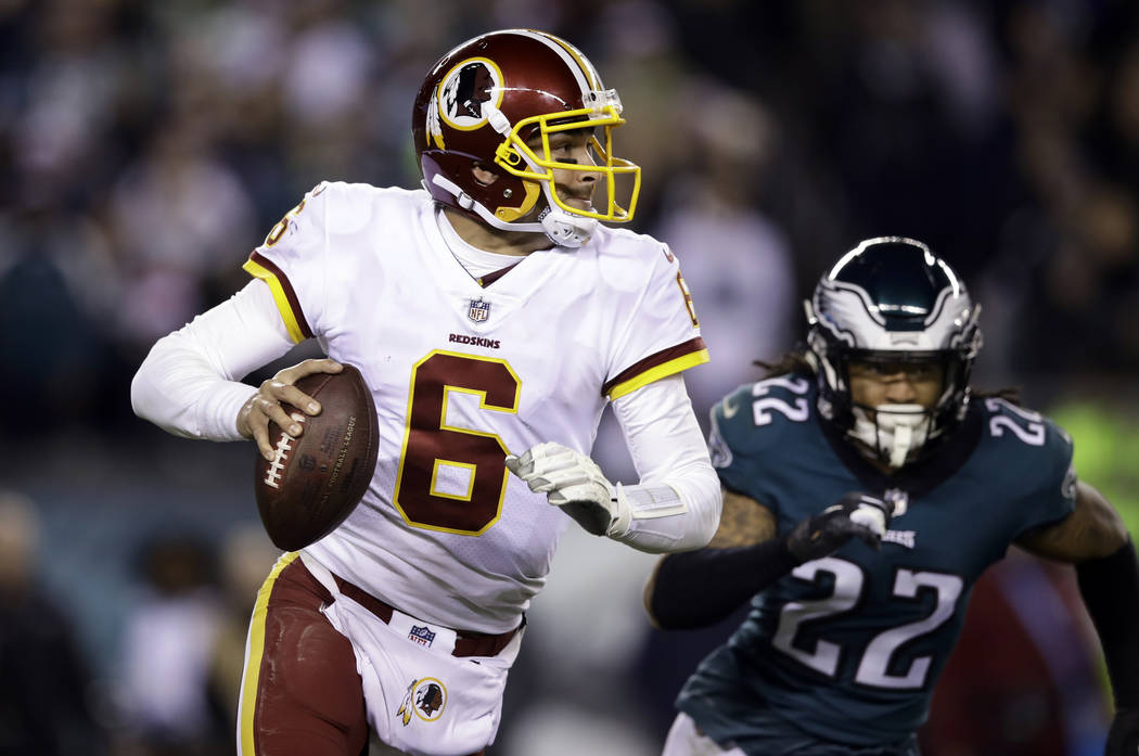 FILE - In this Monday, Dec. 3, 2018, file photo, Washington Redskins quarterback Mark Sanchez (6) looks to pass during an NFL football game against the Philadelphia Eagles,, Philadelphia. The 32-y ...