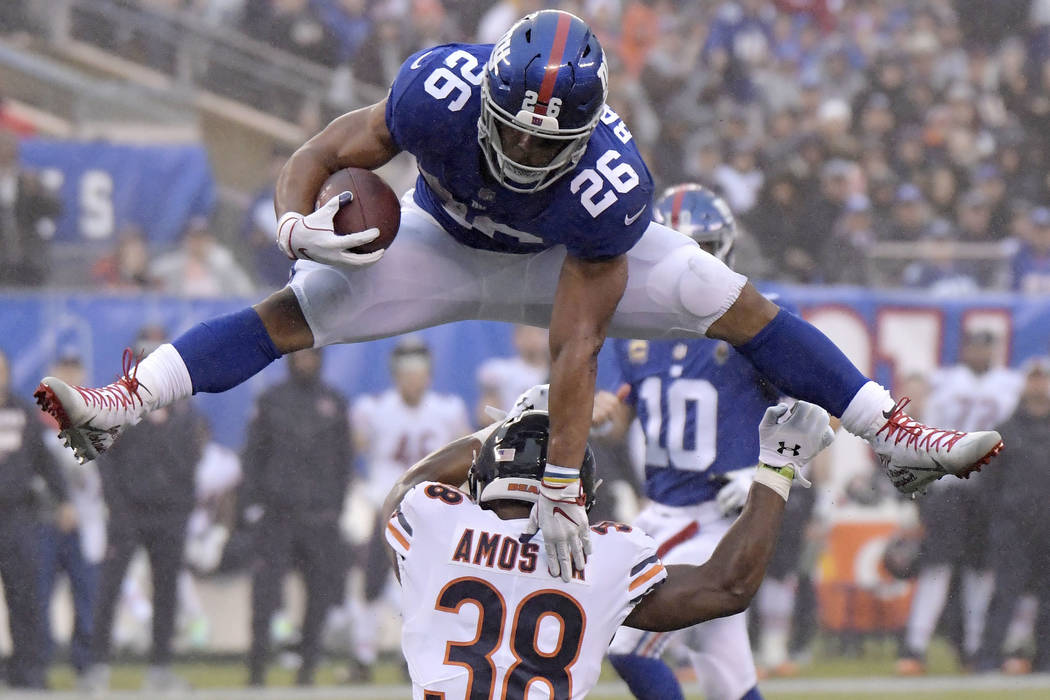 New York Giants running back Saquon Barkley (26) leaps over Chicago Bears  strong safety 9a6f6d4f2