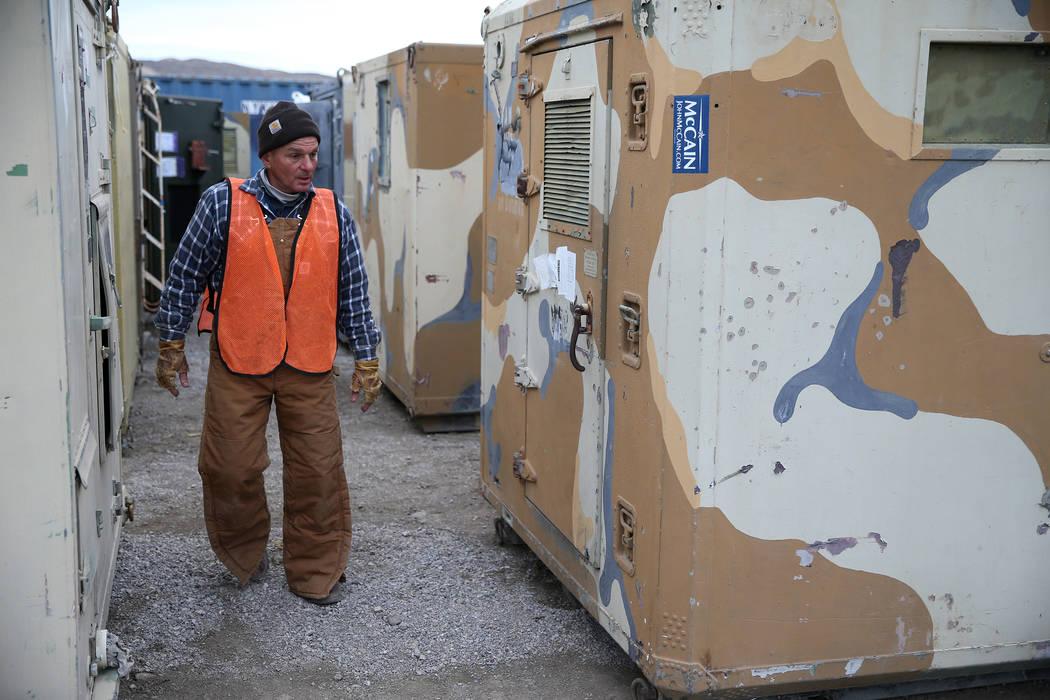 Employee David Boeckle walks through the military storage containers for auction at the Ritchie Bros. auction house in Las Vegas, Thursday, Dec. 6, 2018. Erik Verduzco Las Vegas Review-Journal @Er ...