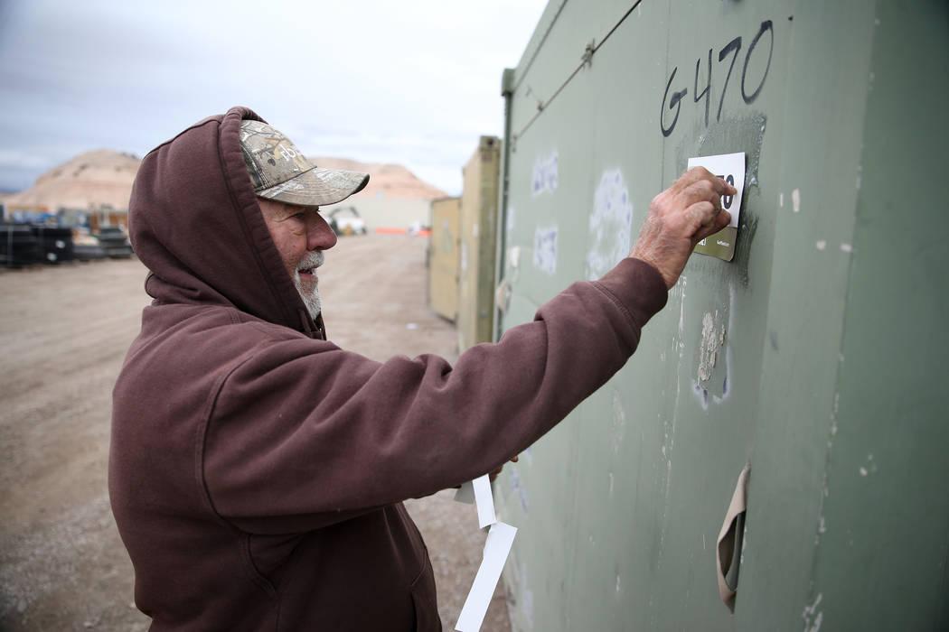 Employee Dave Loch marks a military storage container for auction at the Ritchie Bros. auction house in Las Vegas, Thursday, Dec. 6, 2018. Erik Verduzco Las Vegas Review-Journal @Erik_Verduzco