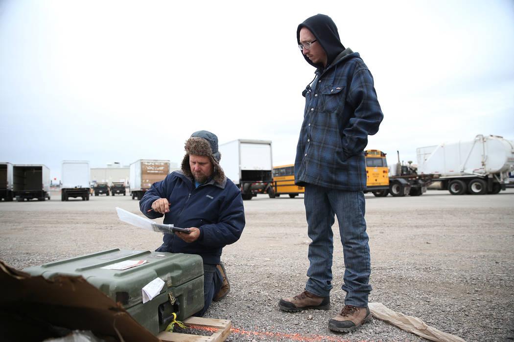 Carl Collis, left, and his son Carson, 19, browse military equipment for auction at the Ritchie Bros. auction house in Las Vegas, Thursday, Dec. 6, 2018. Erik Verduzco Las Vegas Review-Journal @Er ...