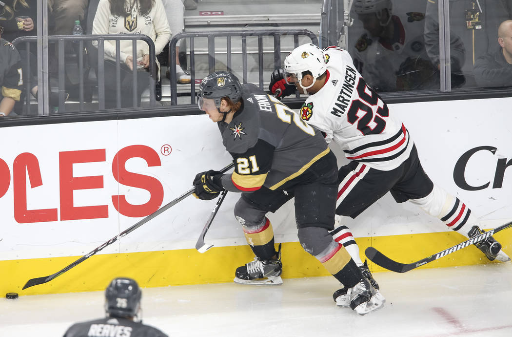 Vegas Golden Knights center Cody Eakin (21) and Chicago Blackhawks left wing Andreas Martinsen (29) vie for the puck during the second period of an NHL hockey game at T-Mobile Arena in Las Vegas, ...