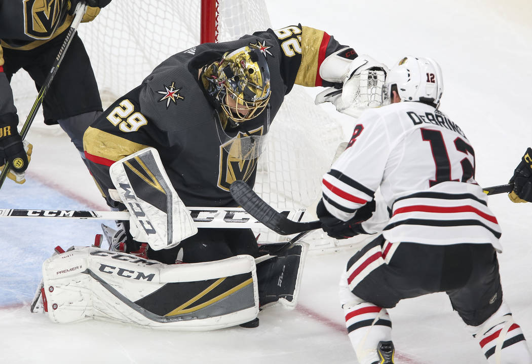 Vegas Golden Knights goaltender Marc-Andre Fleury (29) defends a shot by Chicago Blackhawks left wing Alex DeBrincat (12) during the third period of an NHL hockey game at T-Mobile Arena in Las Veg ...