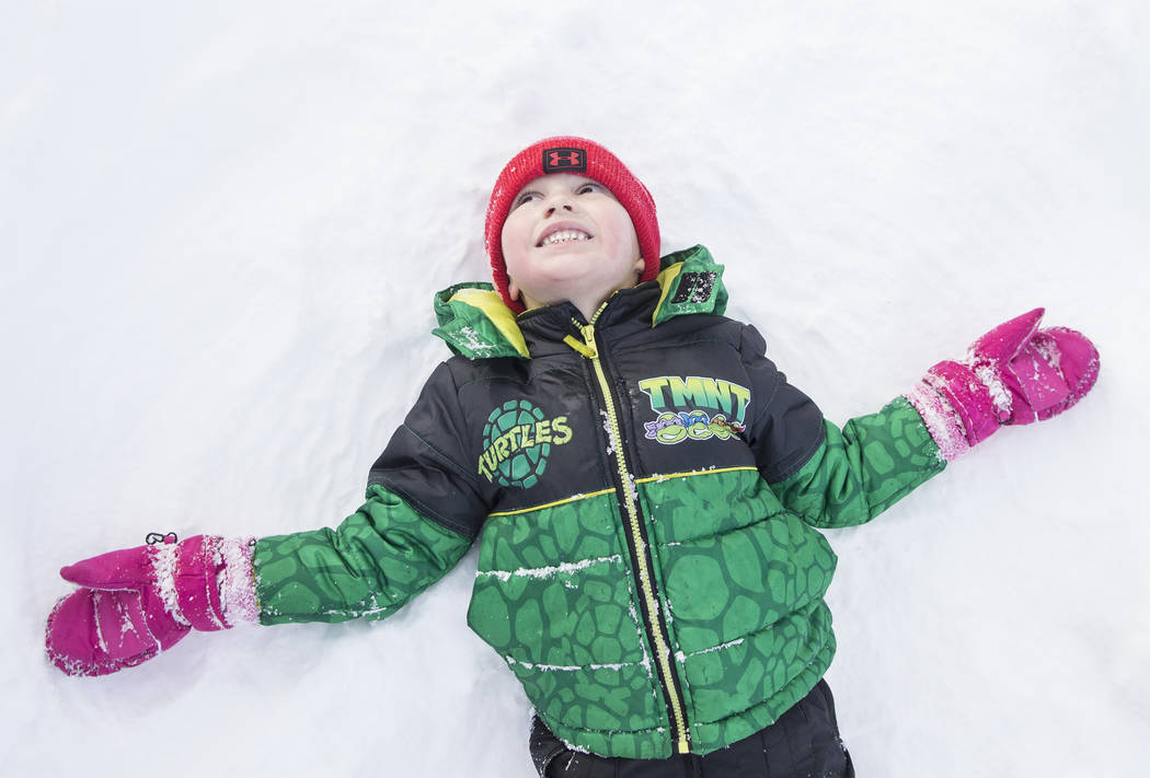 Brody Austen, 4, makes a snow angel at Lee Meadows on Friday, Nov. 30, 2018, outside Lee Canyon, in Las Vegas. Benjamin Hager Las Vegas Review-Journal