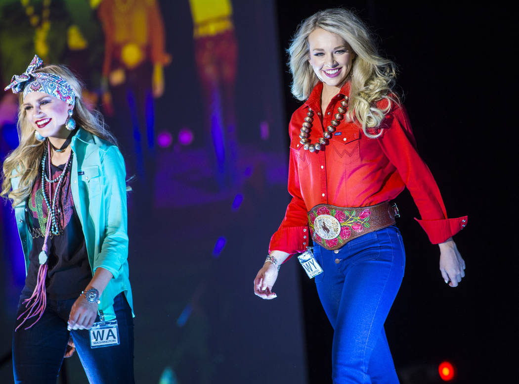 Miss Rodeo Washington Beth Snider, left, and Miss Rodeo Wyoming Morgan Wallace walk on the runway during the Miss Rodeo America Fashion Show at the Tropicana Las Vegas in Las Vegas on Friday, Dec. ...