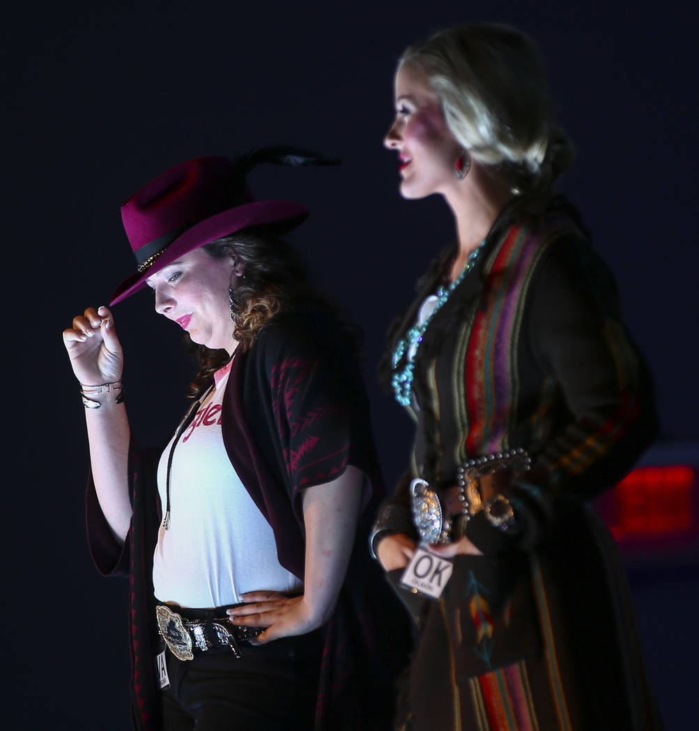 Miss Rodeo Virginia Elizabeth Jones, left, and Miss Rodeo Oklahoma Taylor Spears pose on the runway during the Miss Rodeo America Fashion Show at the Tropicana Las Vegas in Las Vegas on Friday, De ...