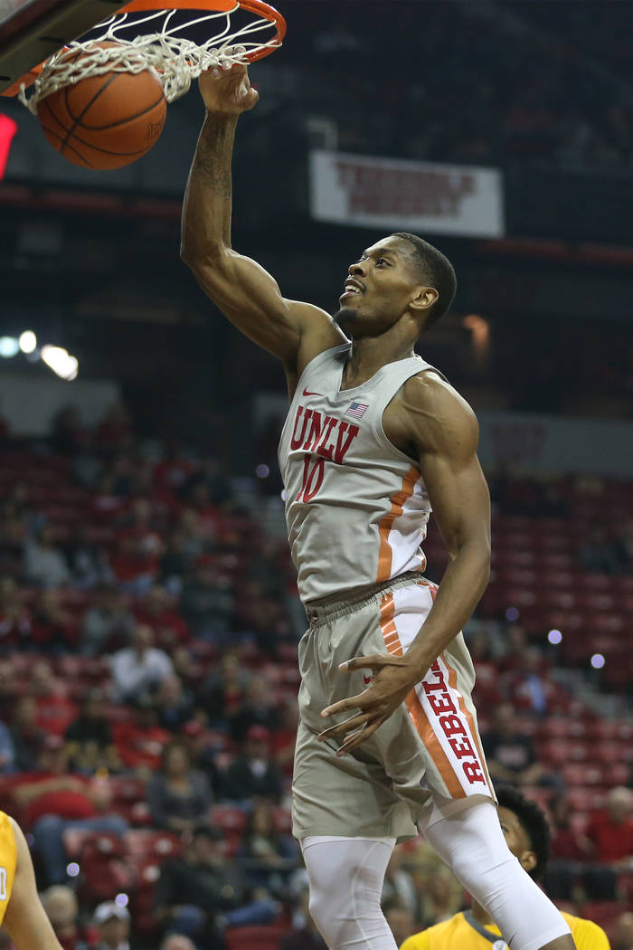 UNLV Rebels forward Shakur Juiston (10) dunks the ball for a score against Valparaiso Crusaders during the first half of the basketball game at the Thomas & Mack Center in Las Vegas, Wednesday ...