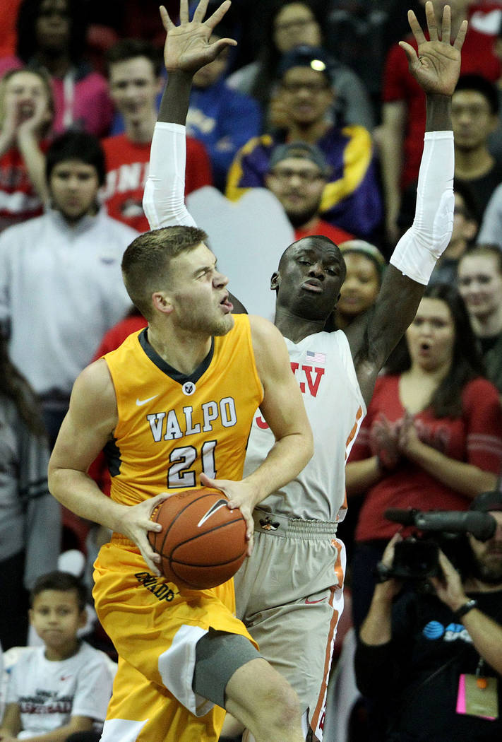Valparaiso Crusaders center Derrik Smits (21) turns for an offensive foul against UNLV Rebels forward Cheikh Mbacke Diong (34) during the first half of the basketball game at the Thomas & Mack Cen ...