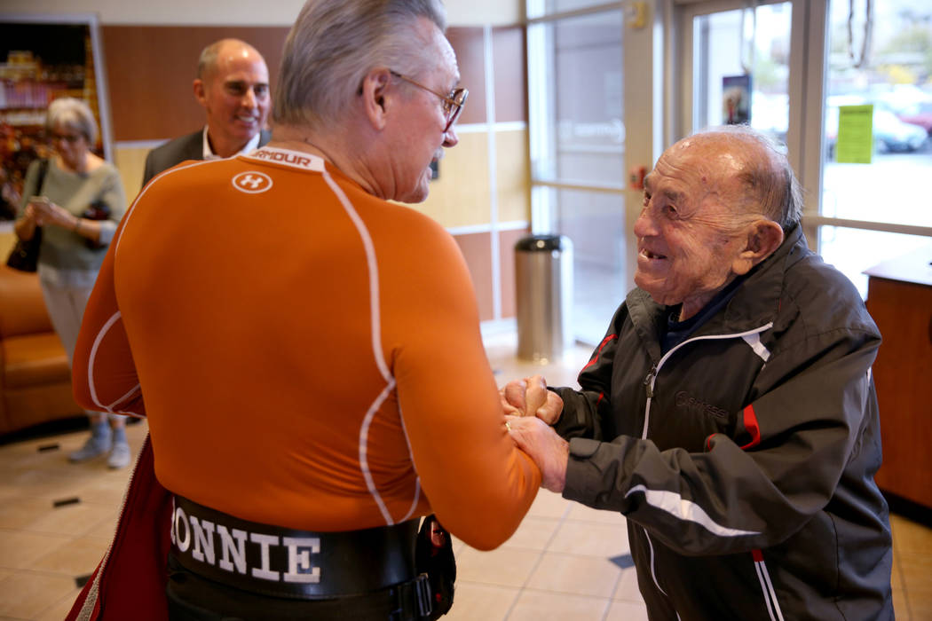 Joe Rosa, of Las Vegas, right, greets Ron Crane upon arrival to his 103rd birthday celebration at 24 Hour Fitness in Summerlin Friday, Dec. 7, 2018. After being the victim of a hit-and-run crash, ...
