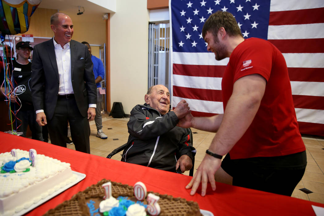 Joe Rosa, of Las Vegas, greets his personal trainer Oleg Kasatkin at his 103rd birthday celebration at 24 Hour Fitness in Summerlin Friday, Dec. 7, 2018. After being the victim of a hit-and-run cr ...
