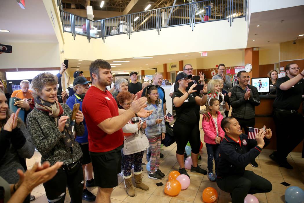 The crowd cheers for Joe Rosa, of Las Vegas, at his 103rd birthday celebration at 24 Hour Fitness in Summerlin Friday, Dec. 7, 2018. After being the victim of a hit-and-run crash, Rosa's medical t ...
