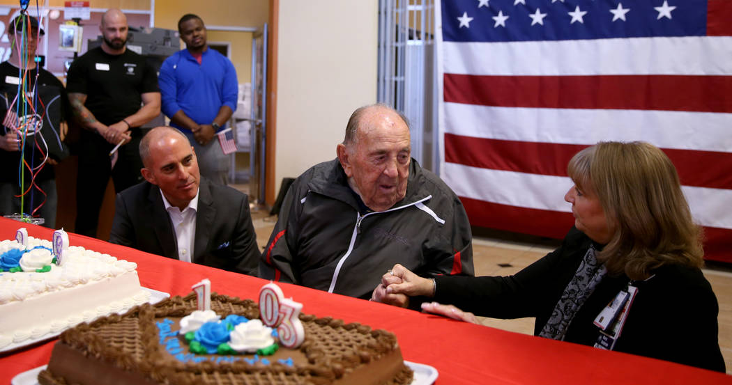 Joe Rosa, of Las Vegas, greets Tracy Skala, VA Southern Nevada Healthcare System associate medical center director at his 103rd birthday celebration at 24 Hour Fitness in Summerlin Friday, Dec. 7, ...
