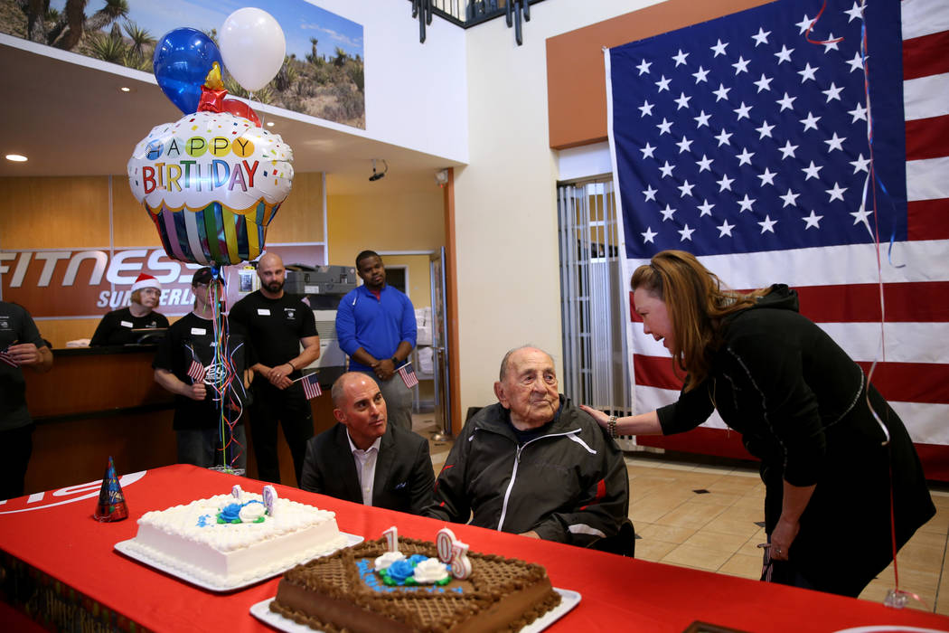 Joe Rosa, of Las Vegas, center, greets Assemblywoman Shannon Bilbray-Axelrod, D-Las Vegas, at his 103rd birthday celebration at 24 Hour Fitness in Summerlin Friday, Dec. 7, 2018. After being the v ...