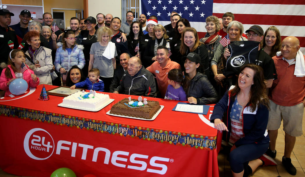 Joe Rosa, of Las Vegas, center, with fellow members and friends during his 103rd birthday celebration at 24 Hour Fitness in Summerlin with the help of club facility technician Jay Michelin Friday, ...