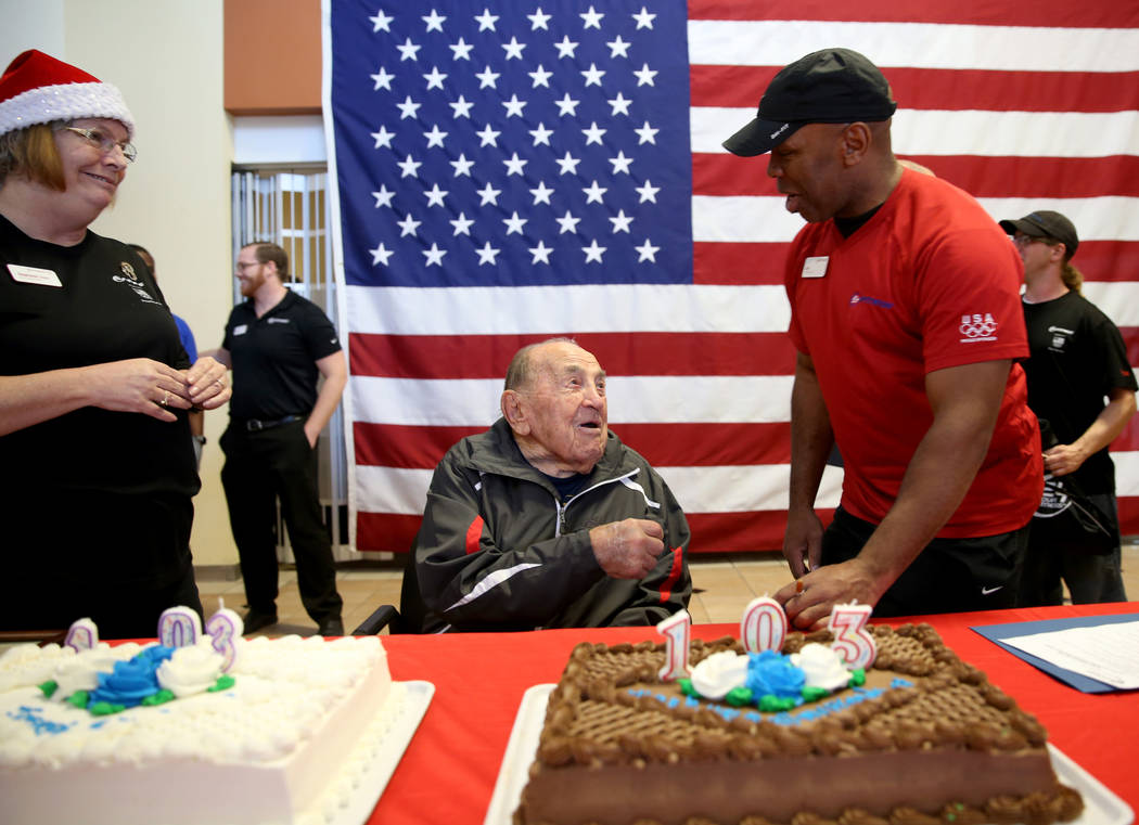 Joe Rosa, of Las Vegas, greets personal trainer Carl Cockerham at his 103rd birthday celebration at 24 Hour Fitness in Summerlin Friday, Dec. 7, 2018. After being the victim of a hit-and-run crash ...