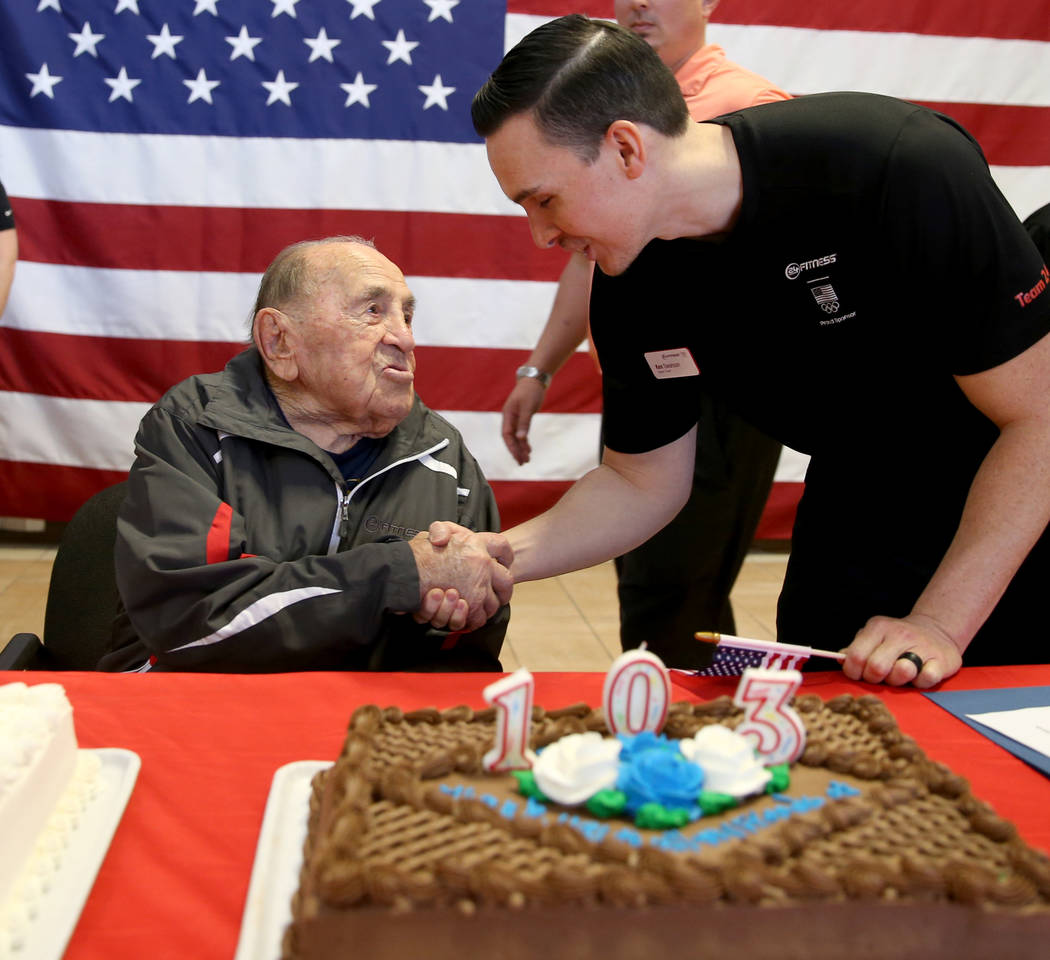 Joe Rosa, of Las Vegas, left, greets personal trainer Ken Swanson at his 103rd birthday celebration at 24 Hour Fitness in Summerlin Friday, Dec. 7, 2018. After being the victim of a hit-and-run cr ...